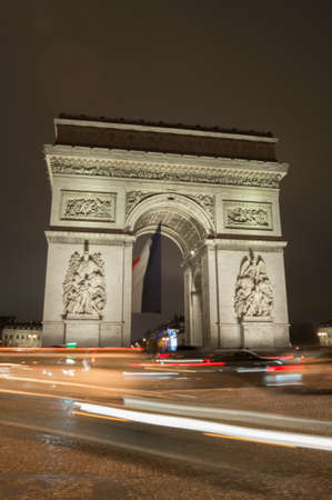 tomb of the unknown soldier: Arc the Triomphe by night with car trails