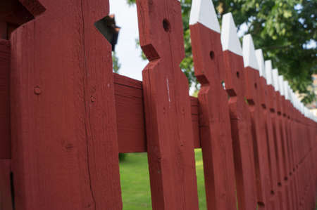 picket fence: A falu red picket fence in Sweden