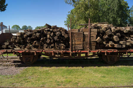 freight train: An antique freight train unit loaded with tree trunks Stock Photo
