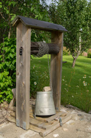 dug well: A traditional well with a bucket in Sweden