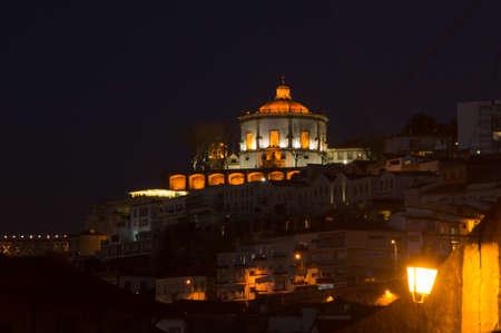 The monastry do Serra do Pilar lit up at night in Porto