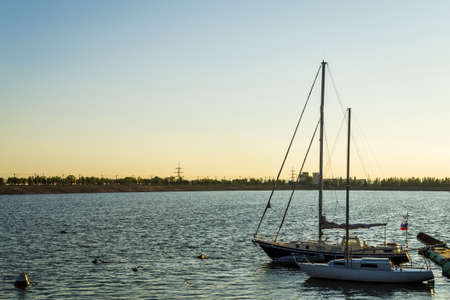 boats on the river sunset river Volga port of ships Stock Photo