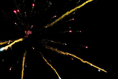 fireworks explosion of color on a dramatic black background focus