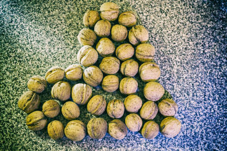 heart eating walnuts in a retro style Stock Photo
