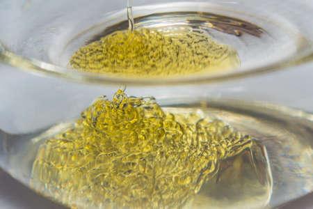 honey in water macro photo close-up of a stream of honey
