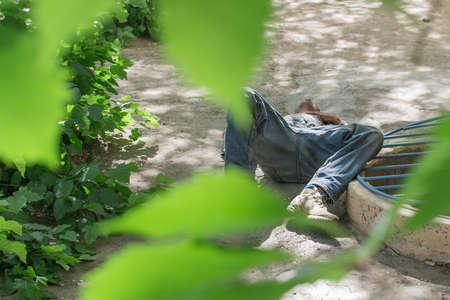 homeless man lies on the ground Stock Photo