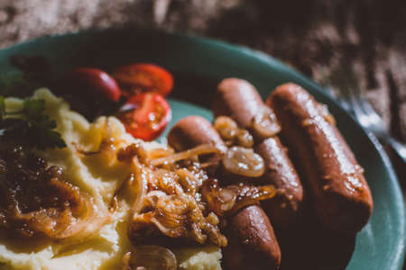 Bangers and mash on a plate for breakfast