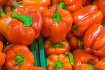 red bell peppers in the supermarket fresh vegetables concept of shopping vegetarianism Banco de Imagens