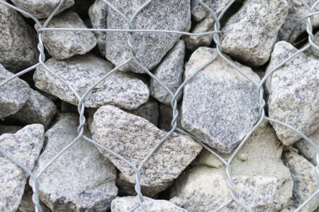 gabion stone wall and lattice background protective stones texture Stock Photo