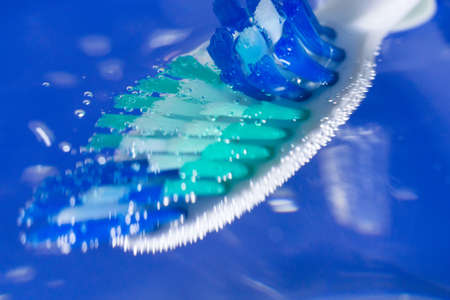toothbrush closeup closeup on a blue background the concept of oral hygiene