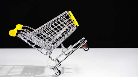 truck shopping for products on an empty black background. the concept of shopping sale