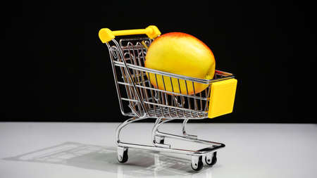 supermarket cart concept of healthy eating. red apple.