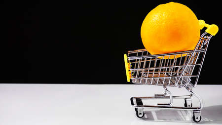 shopping cart buying oranges healthy food concept