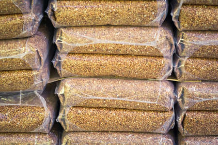 sale of grain packing buckwheat. Agriculture wheat sales Stock Photo