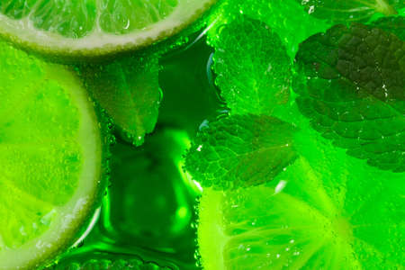 mint and lime in cocktail close-up