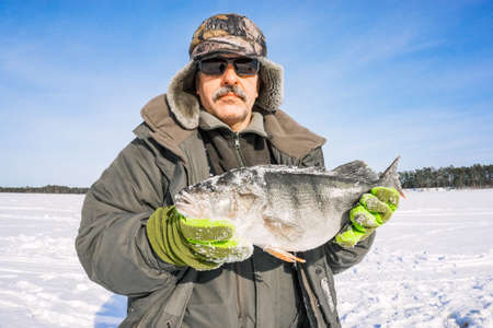 fisherman catch on winter fishing