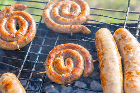 bratwurst, fried sausages on the grill