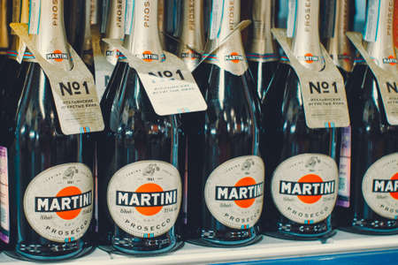 Tyumen, Russia-avg 25, 2019: Products of hypermarket sale Martini beverages in the store metro cash and carry. Martini alcohol sale in store 新闻类图片