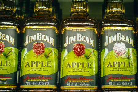Tyumen, Russia-avg 25, 2019: Products of hypermarket sale Jim beam beverages in the store metro cash and carry. Jim beam whiskey Apple sale in the store 新闻类图片