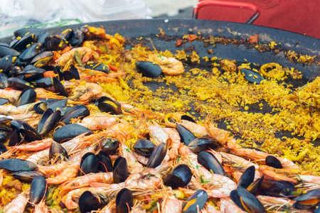 Spanish dish paella closeup cooking