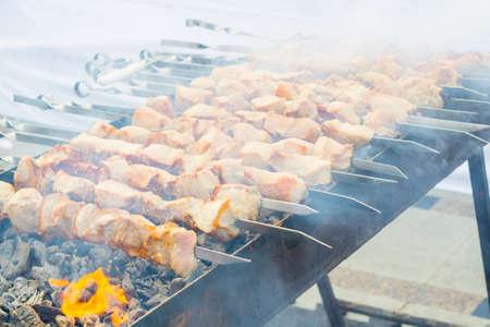 cooking roast pork on coals