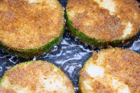 preparation of fried zucchini in oil 写真素材
