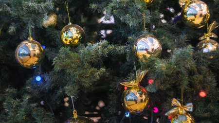 Decorated Christmas tree on blurred, sparkling background