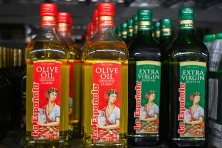 Tyumen, Russia-November 05, 2019: La Espanola olive oils on shelf in supermarket.Sale of goods in the hypermarket Metro cash and carry