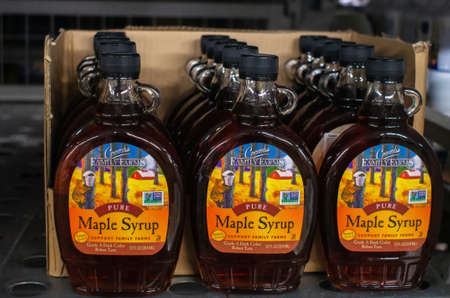 Tyumen, Russia-November 05, 2019: glass bottle of organic maple syrup inside a supermarket. Made by Coombs Family Farms