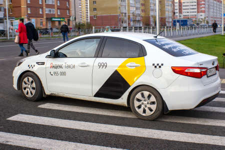 Tyumen, Russia - October 03, 2019: car Yandex taxi on the streets of Tyumen Russia