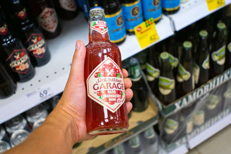Volzhsky, Russia-September 10, 2019: garage hard lemon drink low alcohol drink red with cranberries