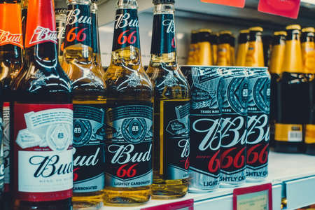 Volzhsky, Russia-September 10, 2019: beer low alcohol drink Bud close up on the shelves of the store Sajtókép