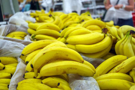 bananas fruit on the market counter. Sale of ripe fruit. supermarketshelf display, bright yellow banana