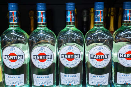 Tyumen, Russia - August 27, 2019: Martini Bianco sale of alcohol in the supermarket vermouth. Close up of Martini Bianco bottles