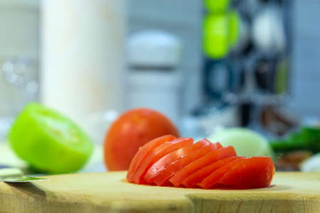 sliced tomatoes on a board in the kitchen. Cooking vegetables cooking salad 写真素材