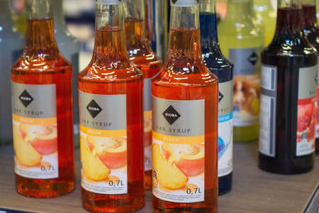 Tyumen, Russia - October 11, 2019: Rioba syrup for cocktails peach in hypermarket metro cash and carry Sajtókép
