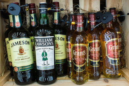 Tyumen, Russia - August 27, 2019: whiskey jameson William lovesons grants whiskey close up sale of spirits