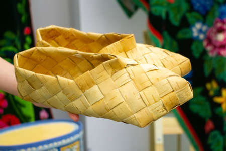 Old Bast shoes - traditional Russian footwear. vintage Russian national shoes - Lapti, bast sandals. Shoes made from bark of tree.