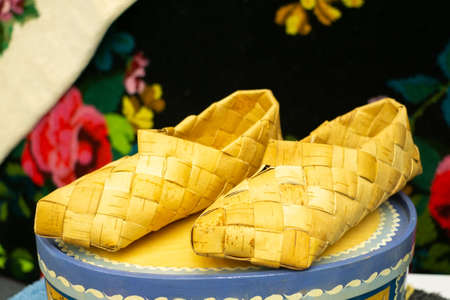 Old bast shoes. Traditional russian footwear. Shoes from the bark of the tree.