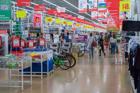 Tyumen, Russia - August 27, 2019: interior of the Auchan hypermarket selling food products Sajtókép