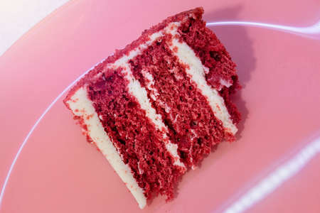Closeup Red Velvet Cake with glass plate. heart background. Suitable for valentine occasion.