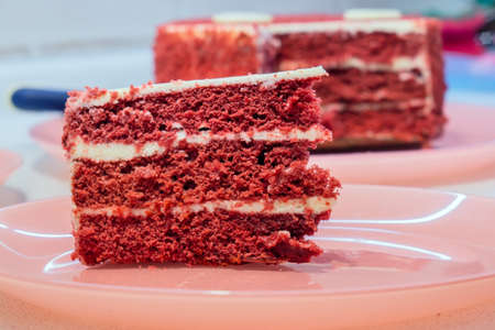 Red velvet cake closeup. chocolate cake dark red, bright red or red-brown color 写真素材