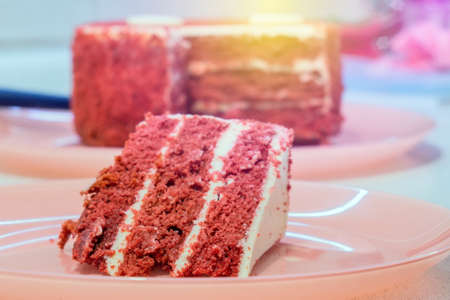 Red velvet cake on a pink background. the stoning. selective focus 写真素材