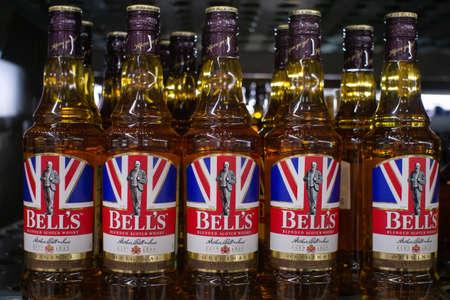 Tyumen, Russia - November 20, 2019: Bottles of bell whiskey on a supermarket shelf.. Sale of alcoholic beverages in the hypermarket Metro.