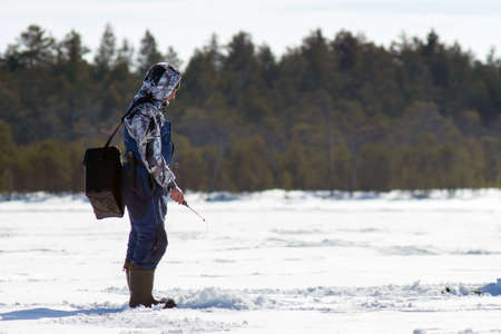 Winter season, Siberia winter fishing, winter sports. Mens hobby, fishing in the winter