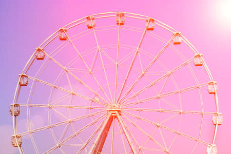 ferris wheel at sunset during summer at county fair