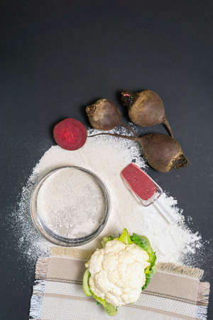 Gluten free flour from vegetables. Healthy food on dark background. the view from the top, flat lay