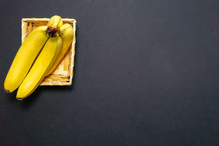 yellow bananas on a black background place for copy space text
