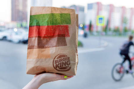 Tyumen, Russia-June 09, 2020: paper bag with food from fast food restaurant Burger king