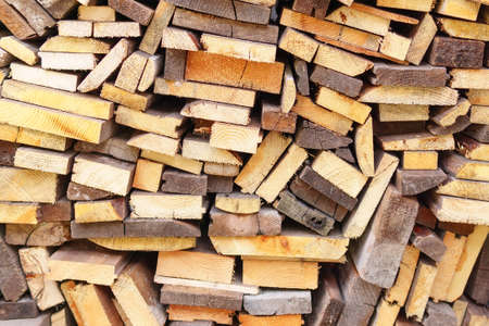 Pile wood. Deforestation theme. Wood industry. Chopped wood Woodpile scene Фото со стока